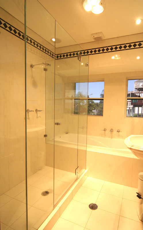 bathroom with marble bathroom floors spa bath and double shower